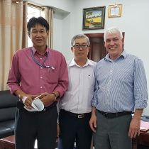 Director of LAA Mr Khamsavhan flanked by David Randell of Scarecrow and Mr Bunn-Tao of Blitz Logistics