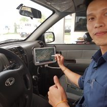 Phetoubon Sisaath from Luang Prabang Airport giving the thumbs up for Scarecrow BIRD Tab