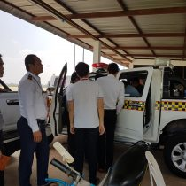 Various trainees wait to get to use the system in the newly acquired vehicle